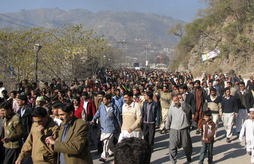 Supporters of assassinated opposition leader Benazir Bhutto march during a protest in Muzaffarabad