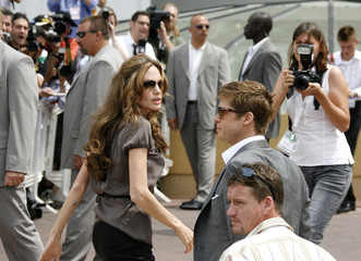 """Angelina Jolie and Brad Pitt arrive for a photocall for British director Michael Winterbottom's film """"A Mighty Heart"""" at Cannes"""