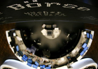 Traders are seen under the DAX board at the German stock exchange in Frankfurt