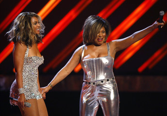 Beyonce Knowles and Tina Turner acknowledge the crowd after their performance at the 50th Annual Grammy Awards held in Los Angeles