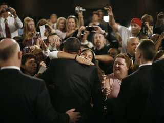 A member of the audience hugs US President Obama after a town hall meeting in Fort Myers