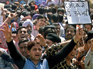 Indian traders raise their hands during a protest against VAT in Amritsar.