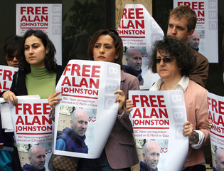 Journalists hold posters during a protest for the release of kidnapped BBC correspondent Alan Johnston, in Beirut