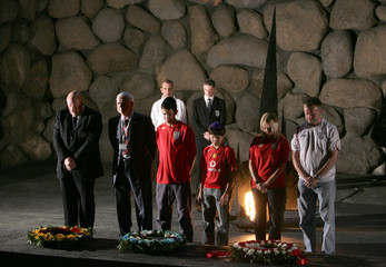England soccer fans and senior officials of the English FA attend a memorial ceremony at the Yad Vashem Holocaust Museum