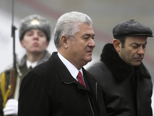 Moldova's President Vladimir Voronin and the CIS Secretary Vladimir Rushailo arrive at Minsk airport for a CIS summit