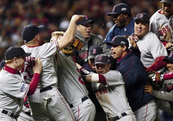Members of the Boston Red Sox celebrate after the Red Sox defeated the Colorado Rockies in Game 4 to win Major League Baseball's World Series in Denver