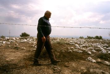 Salim Facmawe walks in the remains of his former village of Umm al-Zinat