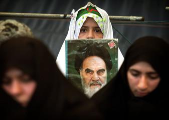 IRANIAN GIRL PREPARES FOR FRIDAY PRAYERS IN TEHRAN.