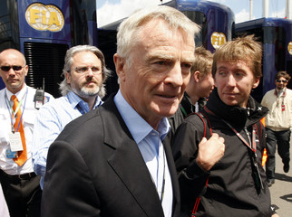 FIA President Max Mosley walks between meetings in the teams paddock area before Sunday's British F1 Grand Prix at Silverstone