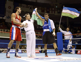 REFEREE RAISES HAND OF UZBEKISTAN'S HAYDAROV AT THE MIDDLE WEIGHT 75 KGFINAL BOUT AT THE 14TH ...