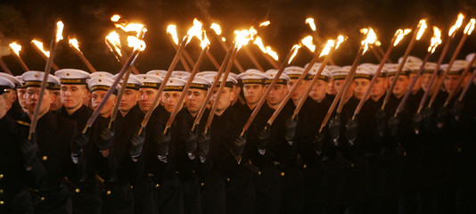 German Bundeswehr soldiers march in a torchlight procession for outgoing German Chancellor Schroeder in Hanover