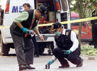INDONESIAN POLICE FORENSIC TEAM INSPECTS THE SITE OF A GRENADEEXPLOSION IN JAKARTA.