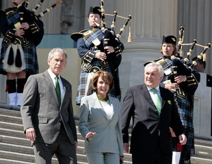 U.S. President Bush walks with Irish Prime Minister Ahern and Speaker Pelosi in Washington