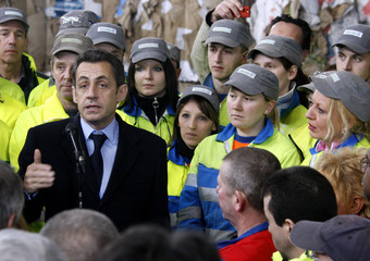 France's President Sarkozy addresses workers as he visits a waste recycle centre in Noyelles Godault