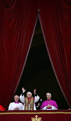 Pope Benedict XVI, Cardinal Joseph Ratzinger of Germany (C) , waves from a balcony of St. Peter's Ba..