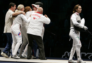 Russian team celebrates after winning the women's fencing foil team final in Turin