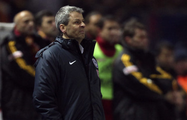 Hertha Berlin's coach Favre reacts during their UEFA Cup soccer match against Galatasaray in Berlin