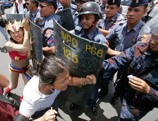 Philippine protesters clash with riot police near the presidential palace in Manila.
