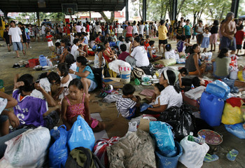 Residents gather in a makeshift evacuation centre after houses were destroyed by flash floods brought by Typhoon Ketsana (Ondoy) in Silangan village