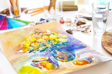 Beautiful water-color drawing on white table, close up view