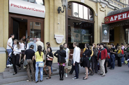 People stand in line outside Pinchuk Art Center which is hosting an exhibition by British artist Hirst in Kiev