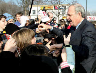 Canadian Prime Minister Martin is greeted by children following a rally in Burlington