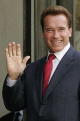 California Governor Schwarzenegger waves as he arrives at the Elysee Palace before a meeting with France's President Sarkozy in Paris