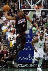 Philiadelphia 76ers' Iguodala passes during NBA game against Boston Celtics in Boston