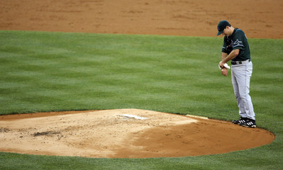 Tampa Bay Devil Rays Corcoran prepares to pitch to New York Yankees Rodriguez in New York