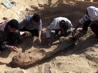 WORKERS UNEARTH 2000 YEAR OLD MUMMY.