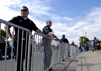 Santa Maria City police watch Michael Jackson fans outside the Santa Barbara County Courthouse in Santa ...