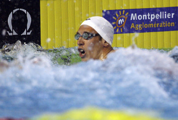 Bernard of France competes in men's 50 meters freestyle during the French Open Swimming Championships in Montpellier