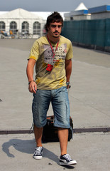Renault's Formula One driver Alonso arrives at the Shanghai race track