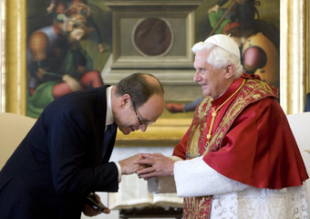 Pope Benedict XVI is greeted by Prince Albert of Monaco during a meeting at the Vatican