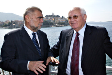 Croatia's President Mesic and former Soviet Union leader Gorbachev talk to each other in Primosten