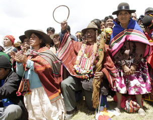 Bolivians gather to watch as President-elect Evo Morales is honored at an Aymara ritual in the Tiwanaku ruins