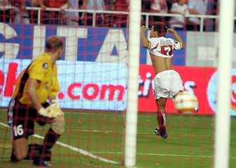 Sevilla's Saviola celebrates his goal against Zenit during their UEFA Cup match in Seville