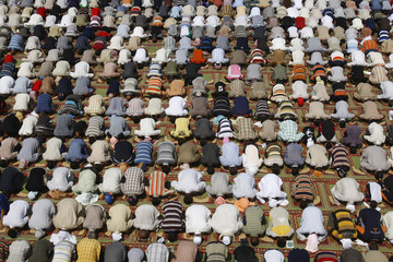Worshippers attend Friday prayers at the Imam Mussa Kadhim shrine in Baghdad