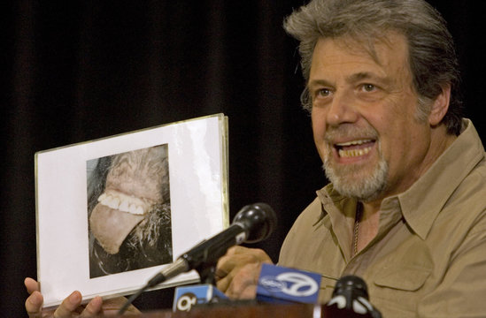 Tom Biscardi, CEO and founder of BIGFOOT Inc., holds up a picture he claims is the mouth of Bigfoot in Palo Alto