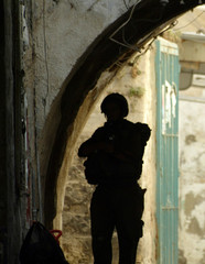 AN ISRAELI SOLDIER PATROLS IN THE OLD CITY OF NABLUS.