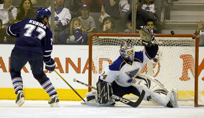 Maple Leafs' Kubina fails to score past Blues' goaltender Legace in shootout giving St Louis the win in their NHL hockey game in Toronto
