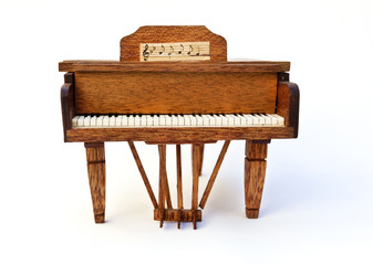 Paper and balsa wood piano. Isolated.