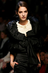 A model presents a creation as part of Moschino's Fall/Winter 2006-2007 women's collection in Milan
