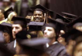LAKERS ONEAL SMILES BETWEEN SEA OF HATS AFTER RECEIVING DEGREE FROM LSU.