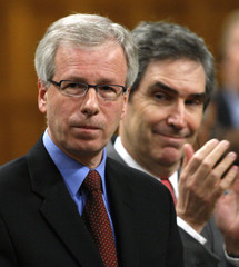 Liberal leader Dion receives a standing ovation from deputy leader Ignatieff in the House of Commons on Parliament Hill in Ottawa