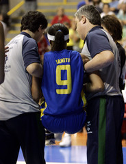 Brazil's Arcain is assisted off court during the Women's World Championship basketball game against Canada in Sao Paulo