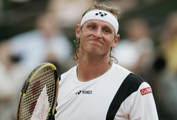 Argentina's Nalbandian reacts during his match with Davydenko of Russia at the French Open tennis tournament at Roland Garros in Paris