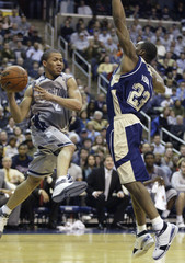Wallace of Georgetown passes the ball off to a teammate during the second half of their NCAA basketball game in Washington