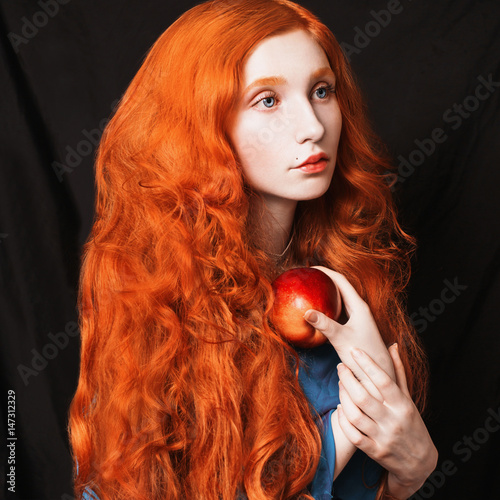 Woman With Long Curly Red Flowing Hair On A Black Background Haired Girl