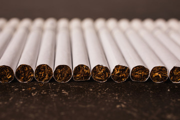 Cigarettes on a dark marble background. Bad habit. Health care
